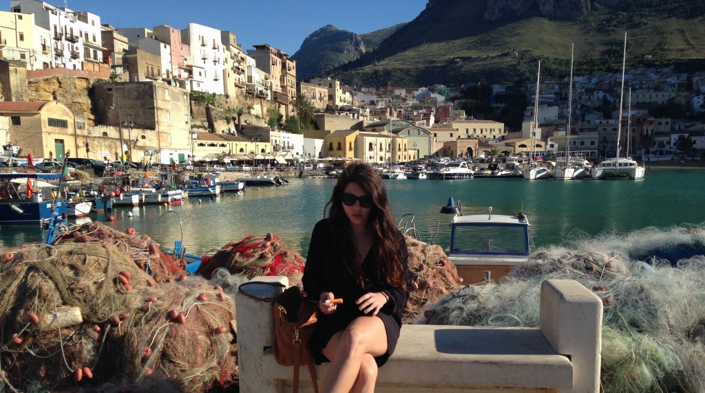 sitting at a fishing bay on the coast of sicily