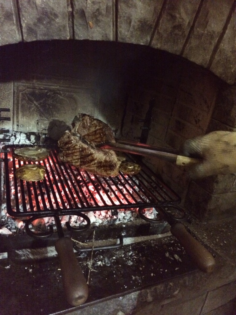 T bone steak (bistecca alla fiorentina) on the grill in our ski chalet