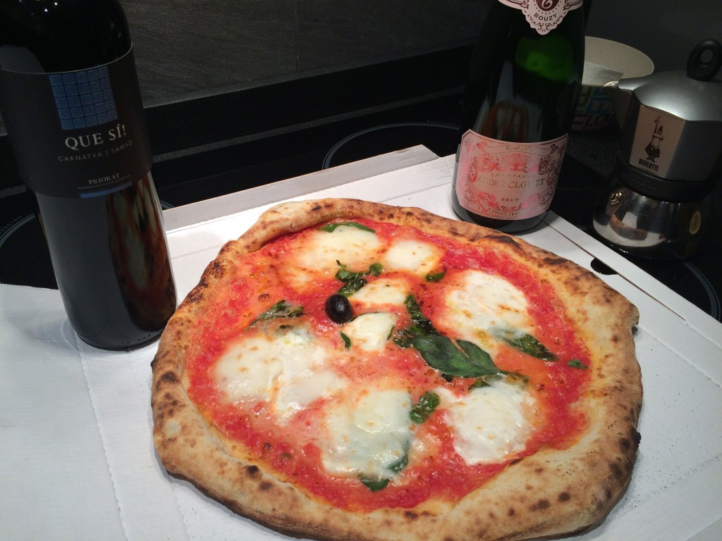 Pizza with red wine and chapagne
