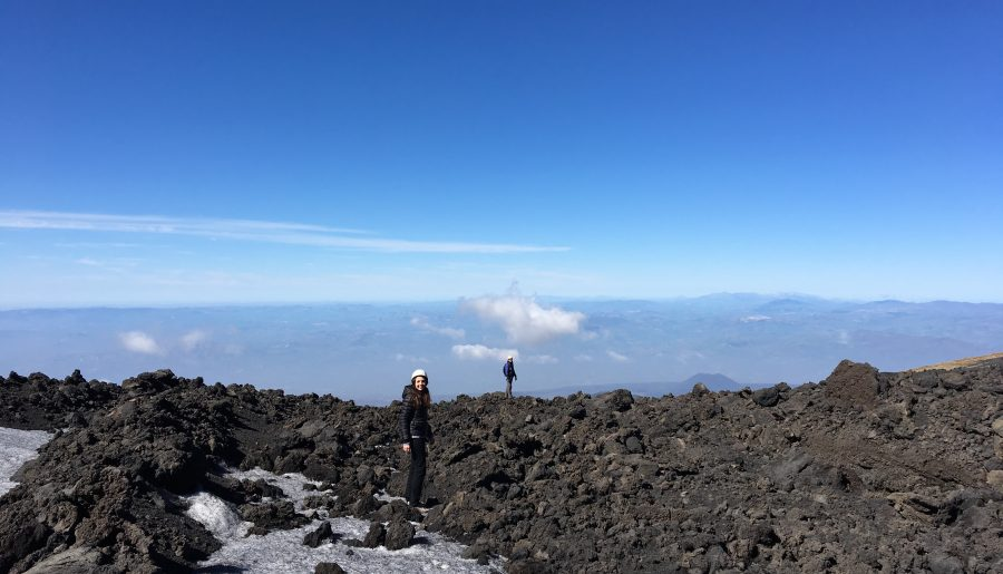 Christina and our guide andrea hiking on the lava at 2500 m height in etna