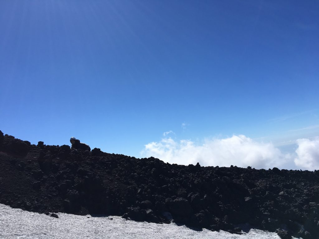 Hiking at the top of volcano etna