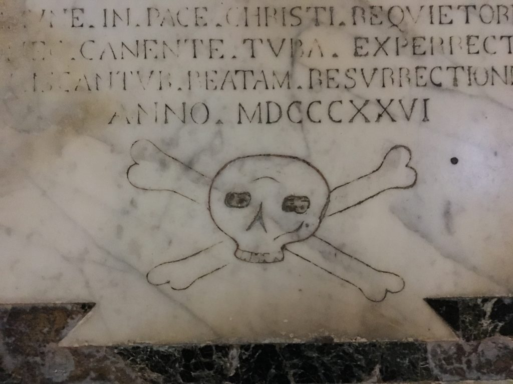 Skull and cross bones from 1826 in the cathedral of syracuse
