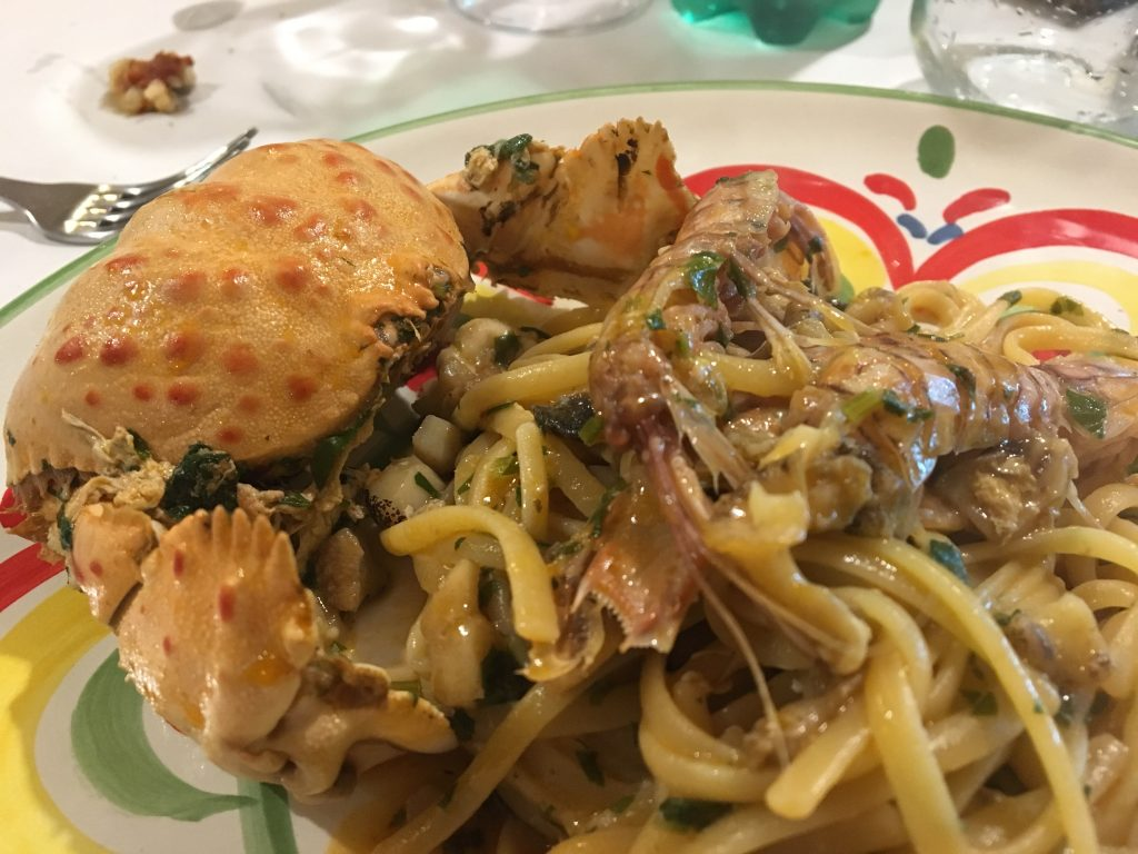 Spaghetti with local crab and shells at the restaurant gente di mare