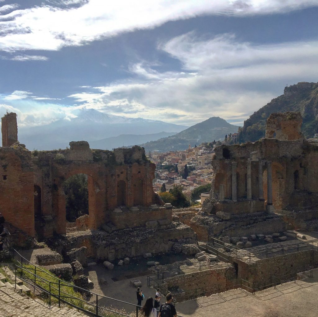 The scenic view of the volcano etna from the ancient theatre of taormina